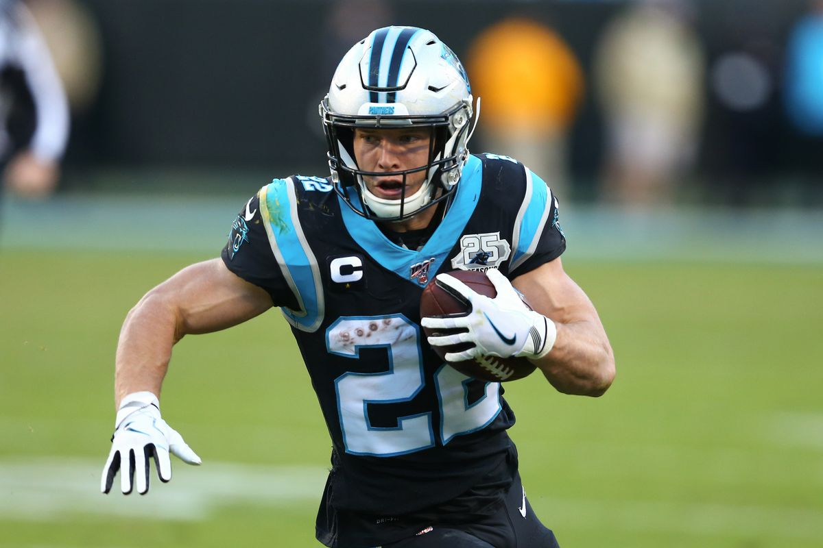 Carolina Panthers running back Christian McCaffrey carries the ball during the fourth quarter against the Washington Redskins at Bank of America Stadium.