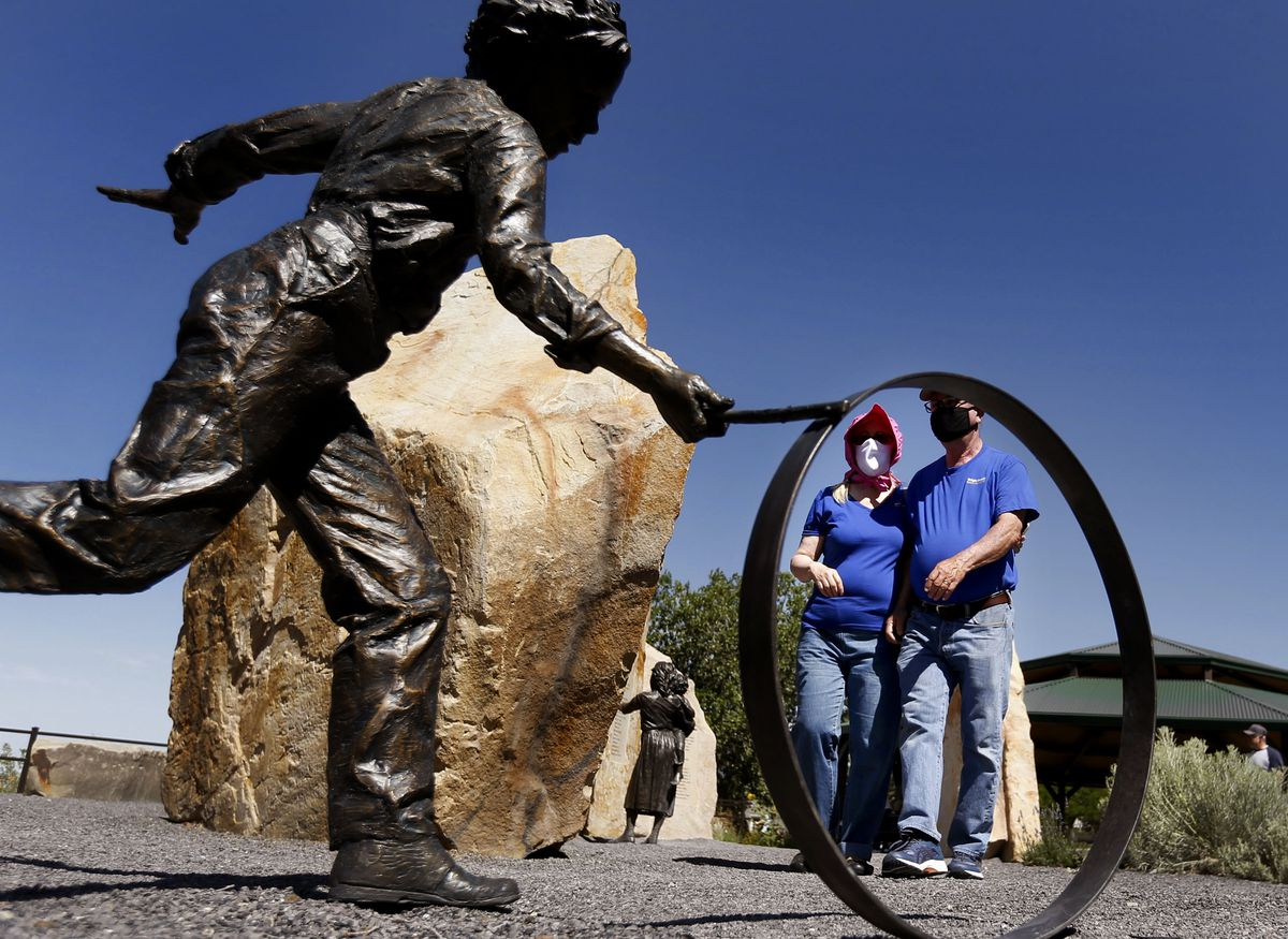 """Carolyn Savage Wright and her husband, David Wright, of Provo tour the Pioneer Children's Memorial at This Is The Place Heritage Park in Salt Lake City on Friday, July 24, 2020. Due to the COVID-19 pandemic, the annual Days of '47 parade was canceled, along with other Pioneer Day celebrations.""""We do something pioneer related every year on the 24th,"""" Savage Wright said. """"We want our kids to have that kind of courage, that kind of dedication, and that kind of character that was standard among the pioneers."""""""