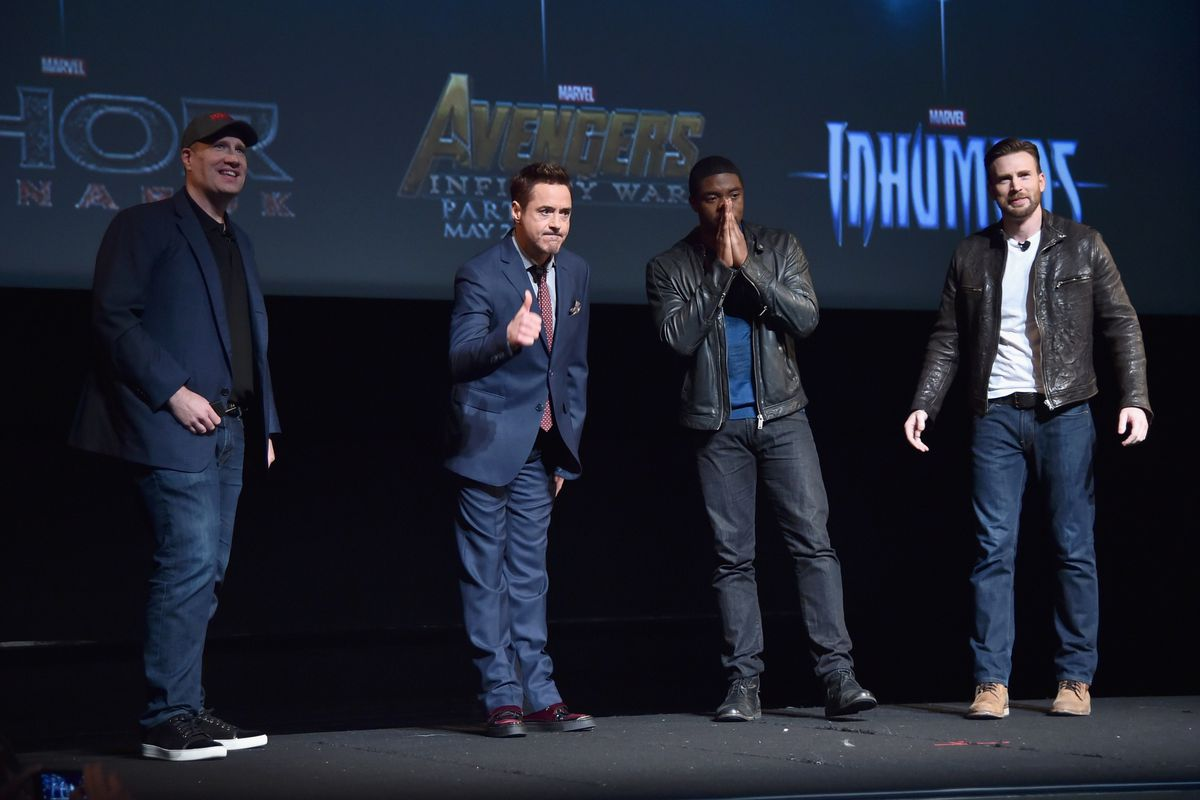 Marvel president Kevin Feige (left) introduces the company's upcoming slate of films with actors Robert Downey, Jr., Chadwick Boseman, and Chris Evans.