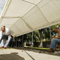 Latter-day Saints and others help Catholics set up for the Carmelite Fair at the monastery in Holladay Tuesday, Sept. 16, 2014.