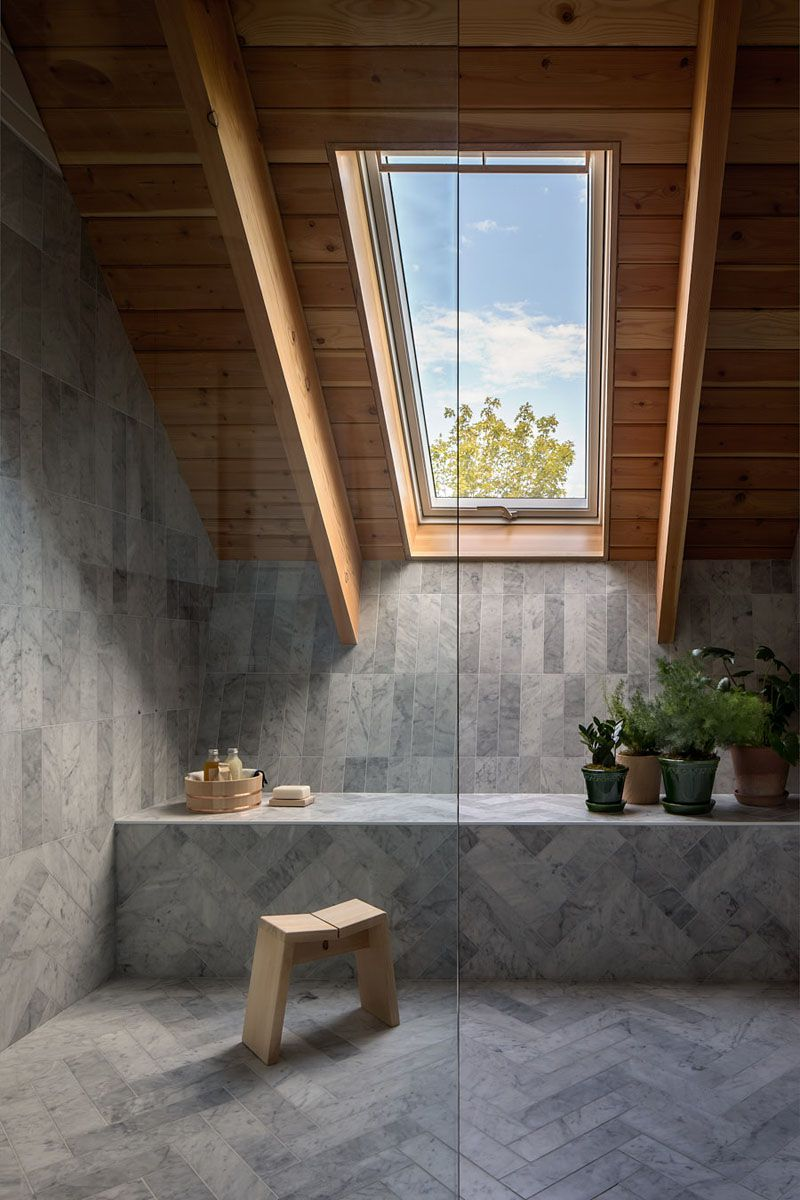 Bathroom with concrete floor and wood ceiling