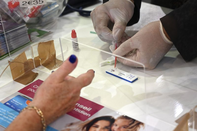 A pharmacist administers a Covid-19 antibody test in Strasbourg, France.
