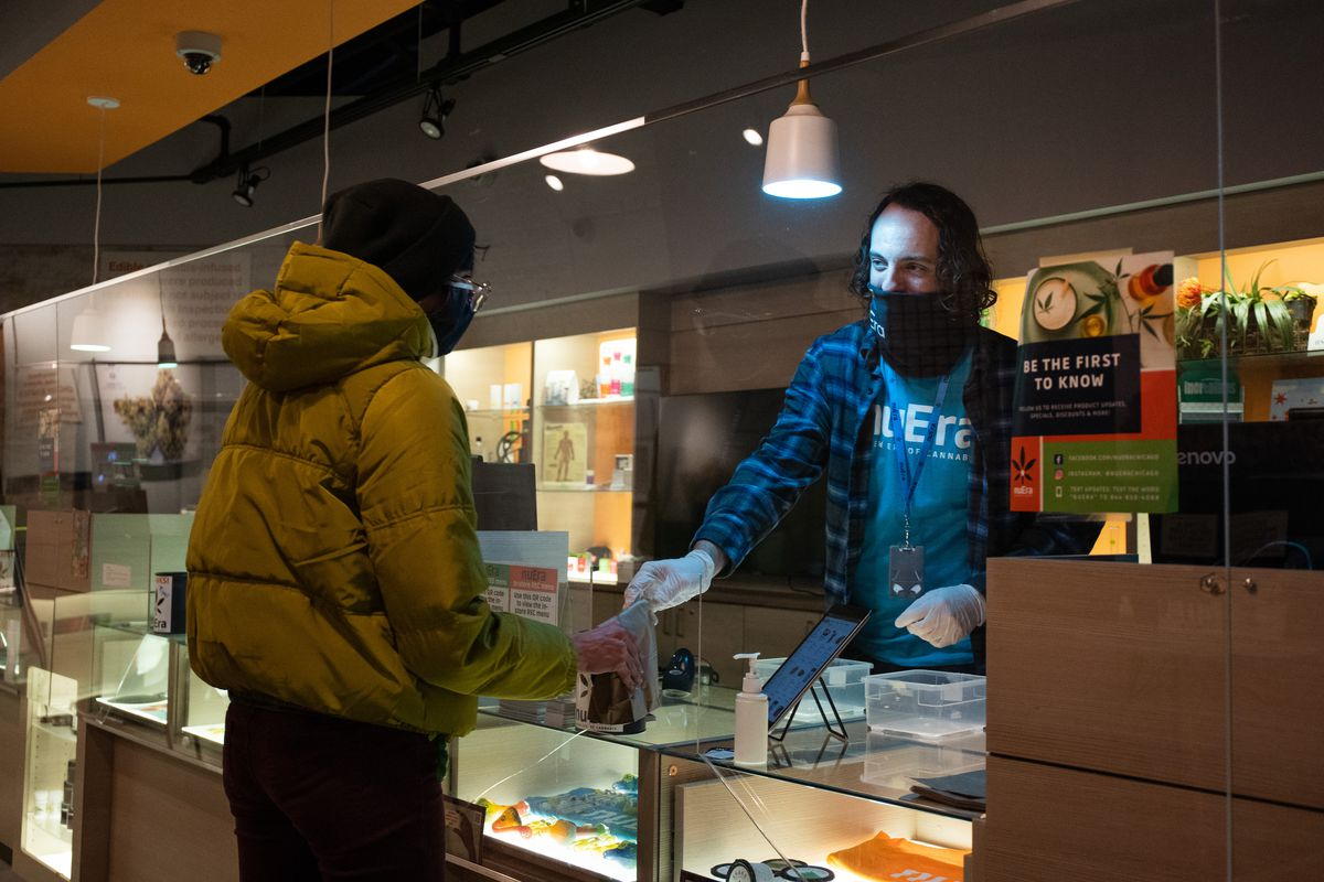 Jon O'Rourke serves a customer at NuEra Cannabis, located at 1308 W. North Ave., Tuesday afternoon, Oct. 27, 2020. | Pat Nabong/Sun-Times