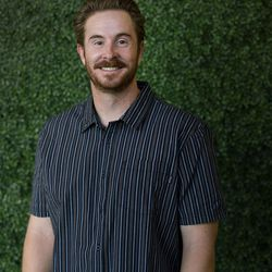 Entrepreneur Cavin Nicholson and his partners have developed a novel, modular backpack system from sustainable/responsible materials and have raised over $650,000 with a Kickstarter campaign. Nicholson poses for a photograph at Publik Coffee Roasters in Salt Lake City on Thursday, June 22, 2017.