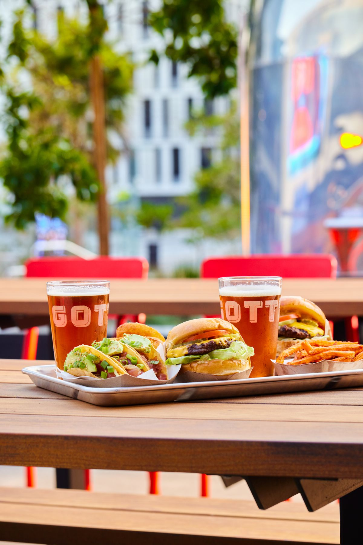 A tray of burgers and beers from Gott's Roadside on a wooden table
