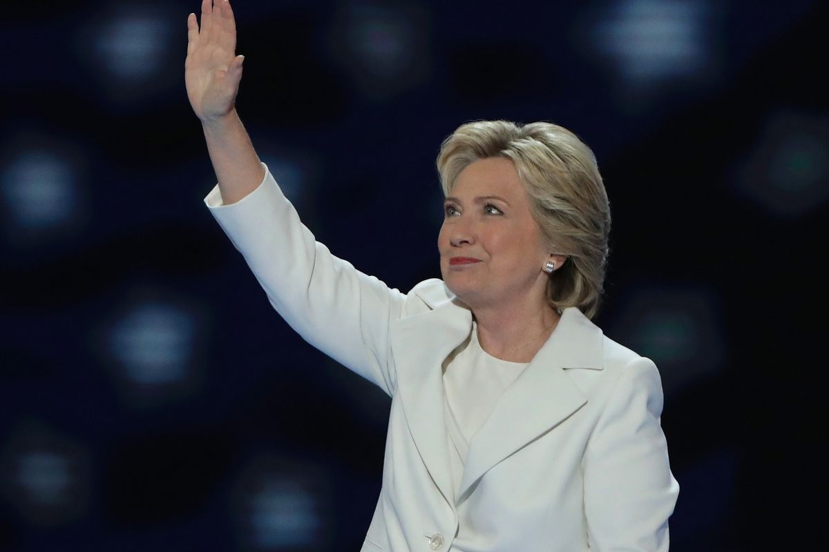 PHILADELPHIA, PA - JULY 28:  Democratic presidential candidate Hillary Clinton acknowledges the crowd as she arrives on stage during the fourth day of the Democratic National Convention at the Wells Fargo Center, July 28, 2016 in Philadelphia, Pennsylvania. Democratic presidential candidate Hillary Clinton received the number of votes needed to secure the party's nomination. An estimated 50,000 people are expected in Philadelphia, including hundreds of protesters and members of the media. The four-day Democratic National Convention kicked off July 25.  (Photo by Alex Wong/Getty Images)