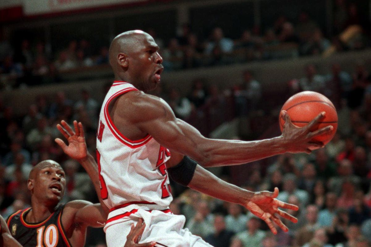 Michael Jordan goes to the basket past Atlanta Hawks' Mookie Blaylock (10) during a May 13, 1997, 107-92 win in Chicago.