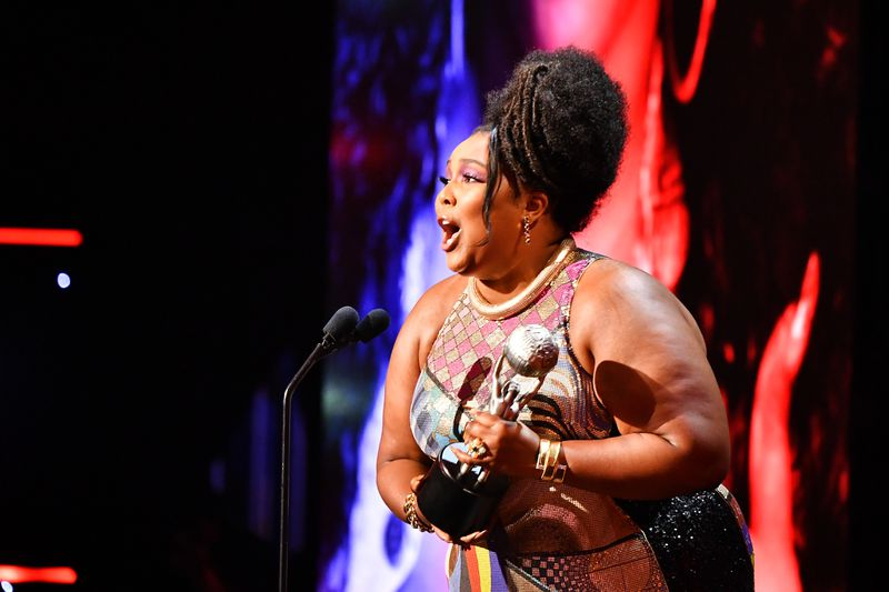 Lizzo accepts the Entertainer of the Year award onstage during the 51st NAACP Image Awards on Saturday night.