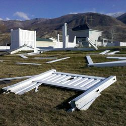 Strong winds downed a vinyl fence in Centerviell Thursday, Dec. 1, 2011 in Salt Lake City.