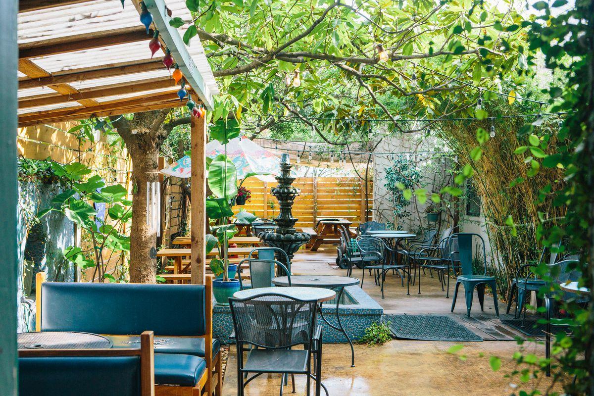 TamaleHouseEast's lush garden patio