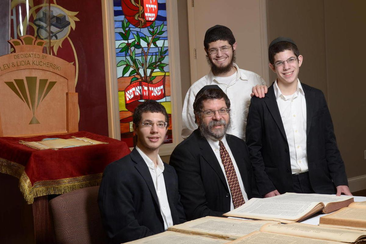 In this photo taken Wednesday, April 4, 2012 released by The Lori Schottenstein Chabad Center shows from left,  son, Mendy, Rabbi Areyah Kaltmann, and sons, Yitzi  and Shea, taken at The Lori Schottenstein Chabad Center in Columbus, Ohio.   Rabbi Areyah K