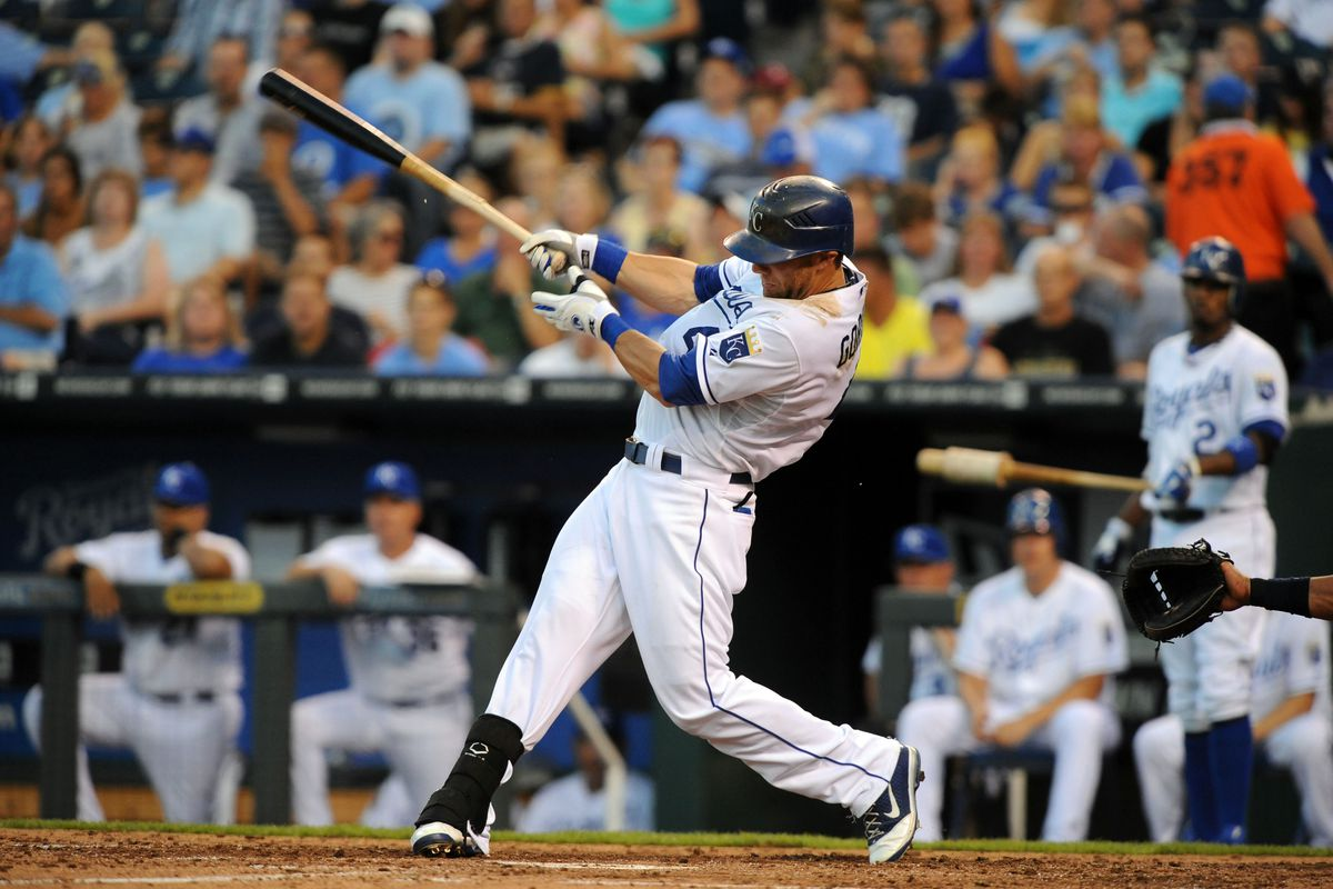 Jul 31, 2012; Kansas City, MO, USA; Kansas City Royals left fielder Alex Gordon (4) drives in a run with a double in the third inning against the Cleveland Indians at Kauffman Stadium. Mandatory Credit: John Rieger-US PRESSWIRE