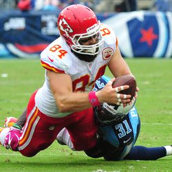 Oct 6, 2013; Nashville, TN, USA; Kansas City Chiefs tight end Sean McGrath (84) catches a pass as Tennessee Titans safety Bernard Pollard (31) defends during the first half at LP Field. The Chiefs won 26-17.