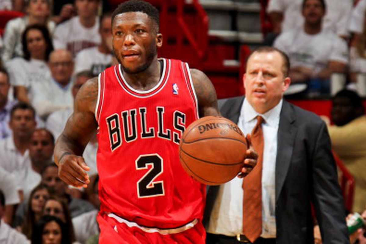MIAMI, FL - MAY 6: Nate Robinson #2 of the Chicago Bulls advances the ball as head coach Tom Thibodeau looks on against the Miami Heat in Game One of the Eastern Conference Semifinals during the 2013 NBA Playoffs on May 6, 2013