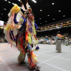 A native dancer walks by during the 29th annual Gathering of Nations in Albuquerque, N.M., on Friday April 27, 2012. The event draws more than 3,000 dancers and singers and tens of thousands of spectators for three days of competitions and the crowning of Miss Indian World.