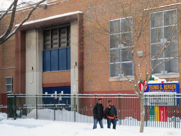 Students walk to school past PS 9, the Teunis Bergen School, in Prospect Heights this morning.