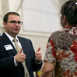 Charles Stormont, Democratic candidate for Utah attorney general, talks to Jo L. Egelund at the Utah Education Association Convention and Education Exposition at the South Towne Expo Center in Sandy on Thursday, Oct. 16, 2014.