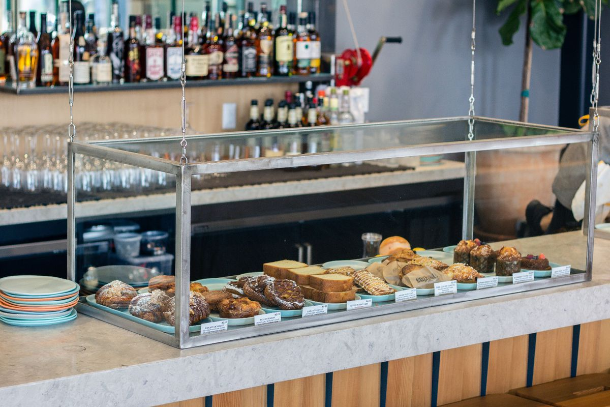 A pastry case stocked with morning pastries from Superba Food + Bread El Segundo.