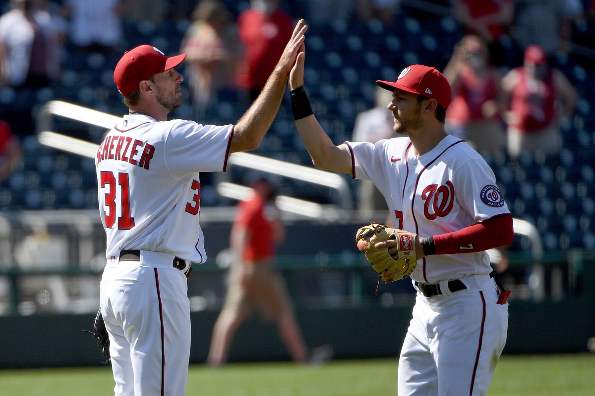 Max Scherzer #31 of the Washington Nationals celebrates with Trea Turner #7 after throwing a complete game against the Miami Marlins at Nationals Park on May 02, 2021 in Washington, DC.