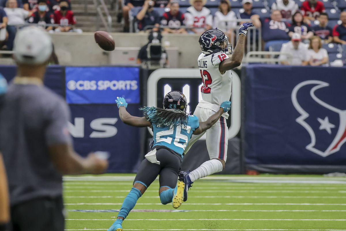Jacksonville Jaguars cornerback Shaquill Griffin (26) reaches to block a catch by Houston Texans wide receiver Nico Collins (12) during the football game between the Jacksonville Jaguars and Houston Texans on September 12, 2021 at NRG Stadium in Houston, Texas.
