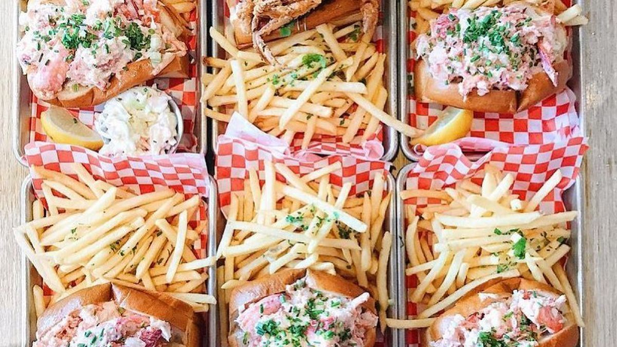A table of lobster rolls and fries from Woodhouse Fish Co.