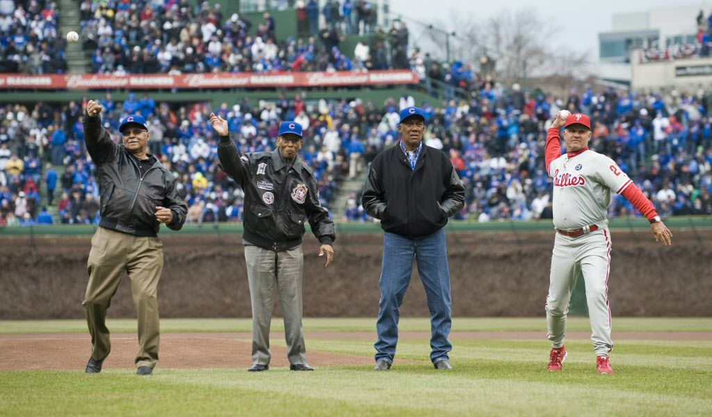 Billy Williams, Ernie Banks, Fergie Jenkins and Ryne Sandberg throw the ceremonial first pitches. The Chicago Cubs host the Philadelphia Phillies in the 2014 home opener at Wrigley Field.    Richard A. Chapman/Sun-Times