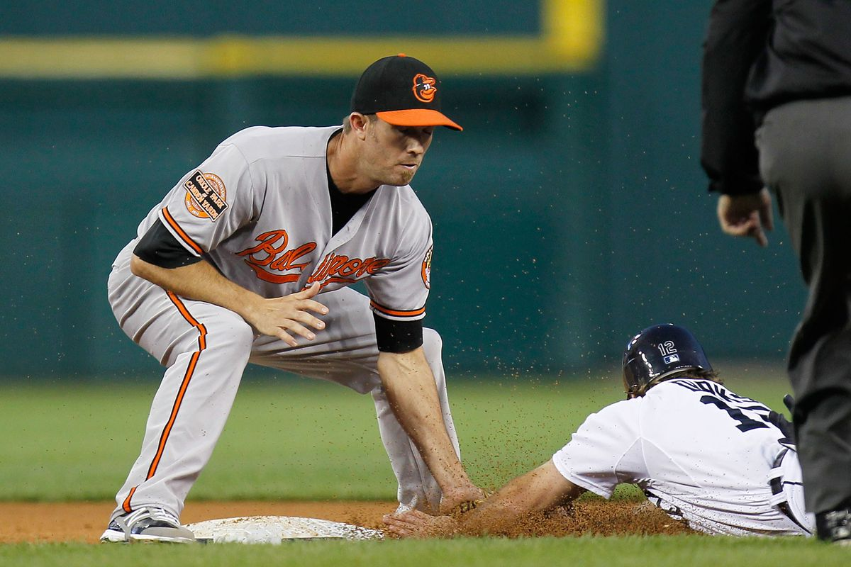 J.J. Hardy #2 of the Baltimore Orioles tags out Andy Dirks #12 of the Detroit Tigers during a fifth inning steal attempt at Comerica Park on August 18, 2012 in Detroit, Michigan. Baltimore won the game 3-2. (Photo by Gregory Shamus/Getty Images)