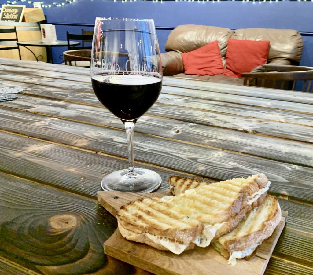 A glass of syrah and a grilled cheese sandwich at Koi Pond Cellars