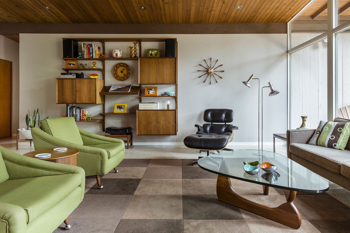 The Living Room Is Decorated With Mostly Vintage Midcentury Modern Furniture