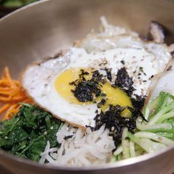 """Bibimbap from Miss Korea by <a href=""""http://www.flickr.com/photos/pabo76/6026565713/in/pool-29939462@N00/"""">Pabo76</a>. <br />"""