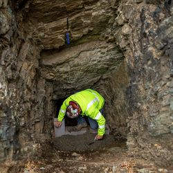 Landon Duckworth, of Strong Solutions, works to close a mine tunnel opening above Layton on Wednesday, Nov. 18, 2020. Strong Solutions was contracted by the Utah Division of Oil, Gas and Mining to close the mine.