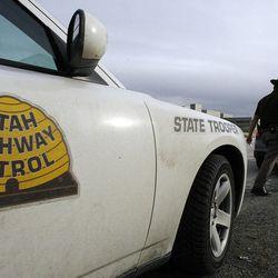 Utah Highway Patrol trooper Carlos Holley makes a stop on I-215 on Thursday, Dec. 13, 2012.