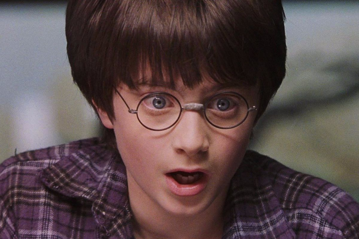 Photo of a shocked, young Harry Potter.