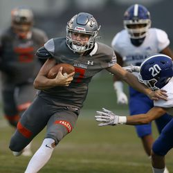 Skyridge quarterback McCae Hillstead runs past Bingham's Chase Cocola (20) at Skyridge High in Lehi on Friday, Aug. 21, 2020. Hillstead completed 16 of 27 passes for 202 yards and four touchdowns.
