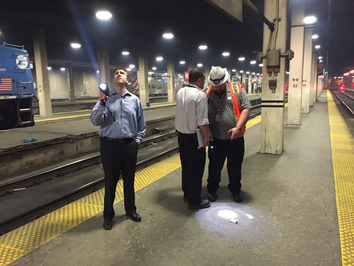 Workers look over the area where chunks fell from the ceiling of Union Station, injuring a woman on Tuesday morning. | Neil Steinberg/Sun-Times
