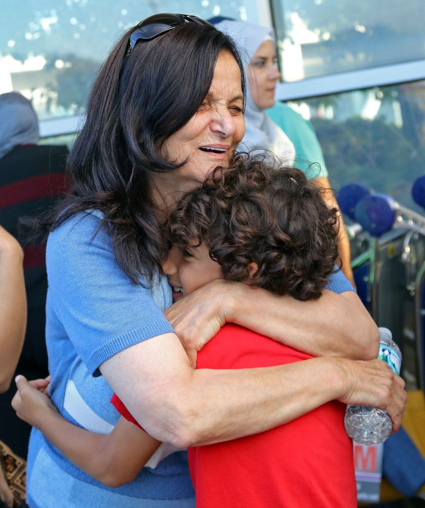 Rasmea Odeh is hugged by Tariq Mohamed at O'Hare Airport on Tuesday. | Tim Boyle/For the Sun-Times