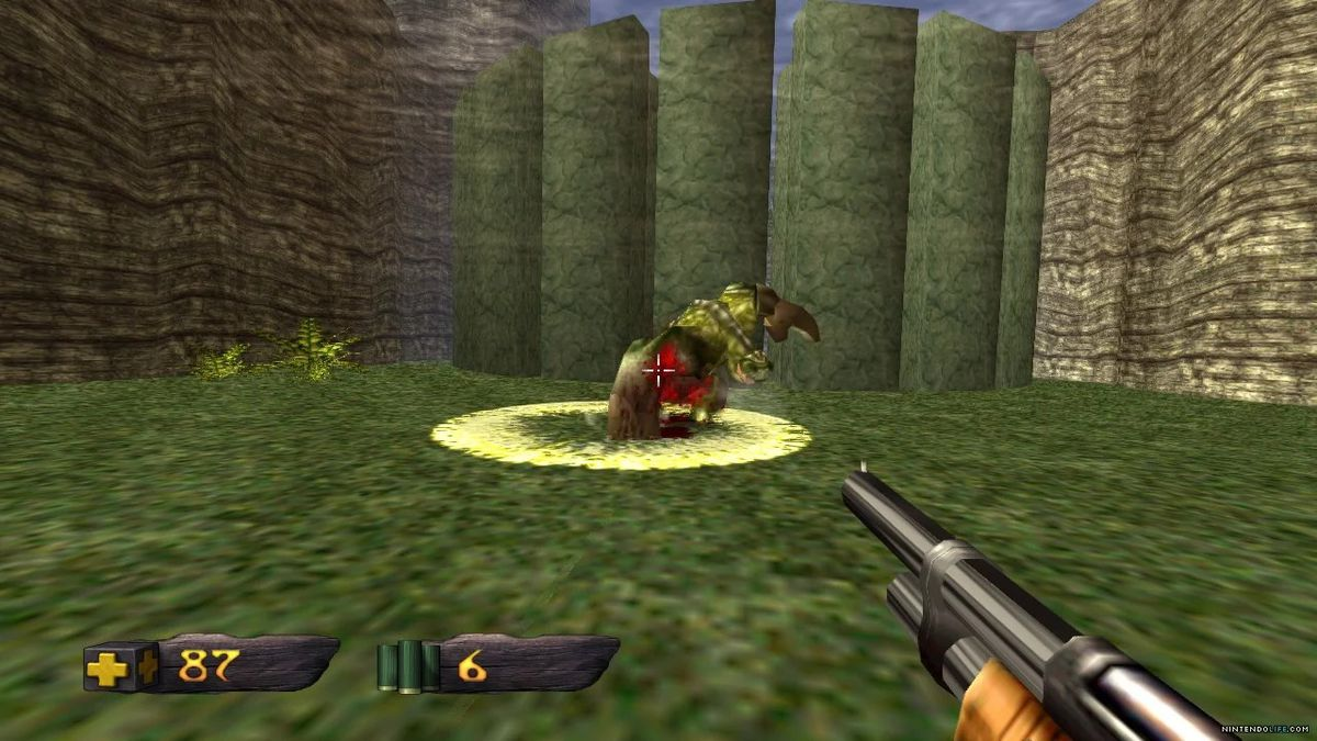 First-person view aiming a shotgun at a dinosaur.