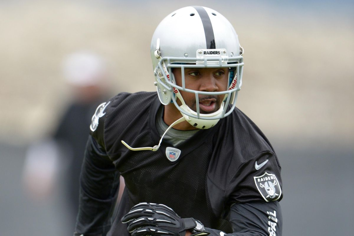 sports shoes 0f747 1bfb4 Charles Woodson takes his old college number - Silver And ...