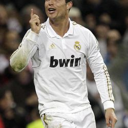Real Madrid's Cristiano Ronaldo from Portugal reacts after scoring during a Spanish La Liga soccer match against Sporting Gijon at the Santiago Bernabeu Stadium in Madrid, Spain, Saturday, April 14, 2012.