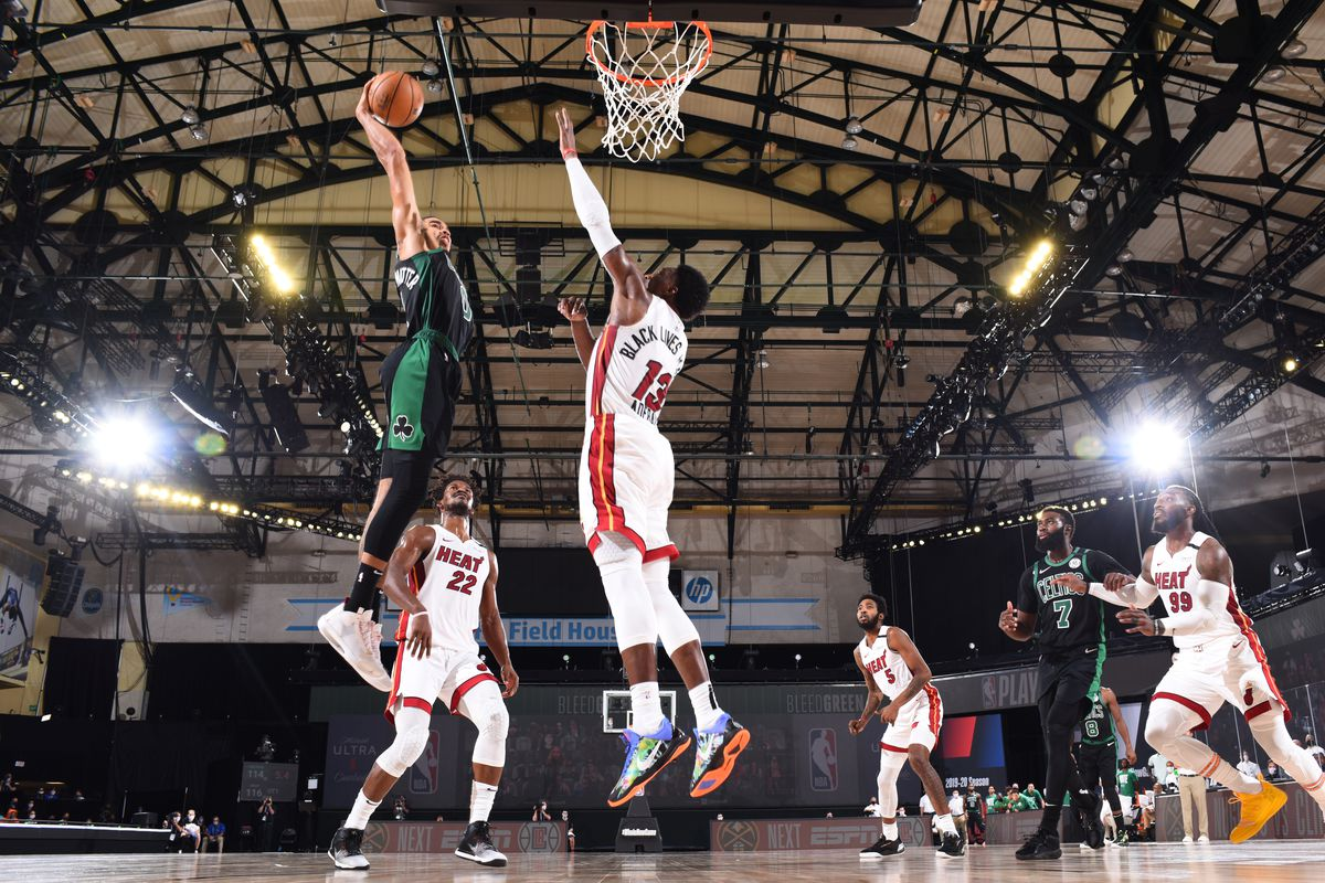 Bam Adebayo of the Miami Heat blocks dunk by Jayson Tatum of the Boston Celtics during Game One of the Eastern Conference Finals of the NBA Playoffs on September 15, 2020 at The Field House in Orlando, Florida.