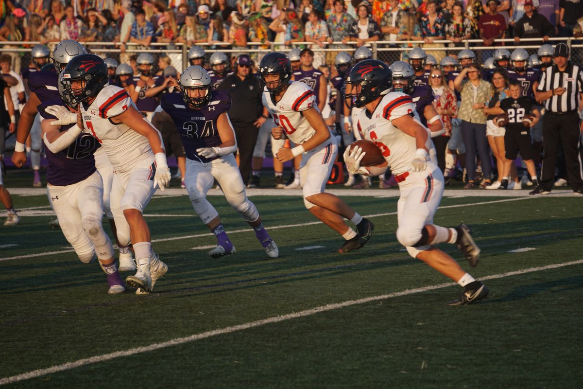 Springville's Seth Rigtrup carries the ball