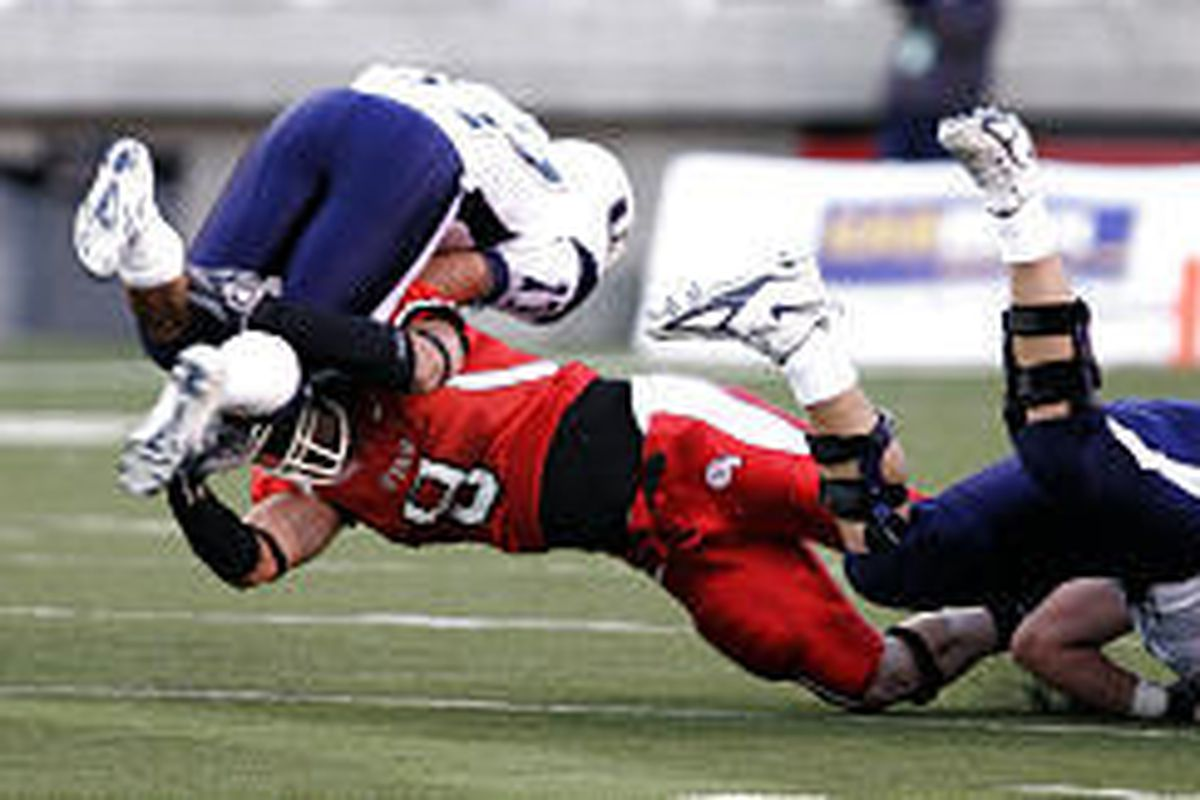 Utah's Spencer Toone tackles Aggie Ryan Bohm, who rushed 11 times for 56 yards and one touchdown.