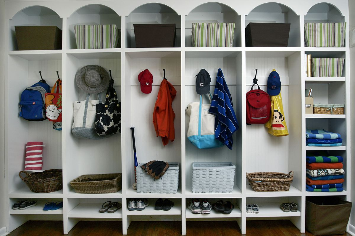 A well-arranged mudroom with lots of shelving.