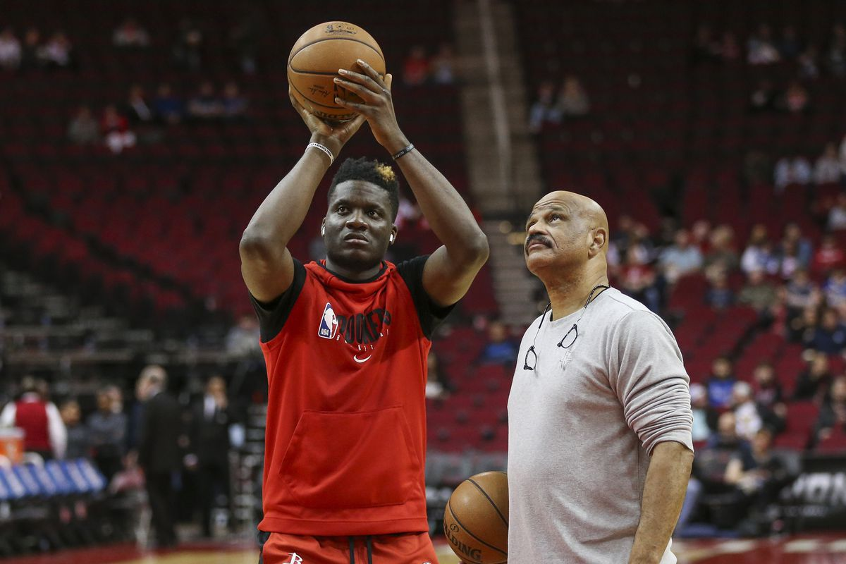 Houston Rockets center Clint Capela practices as coach John Lucas looks on before a game against the Dallas Mavericks at Toyota Center.