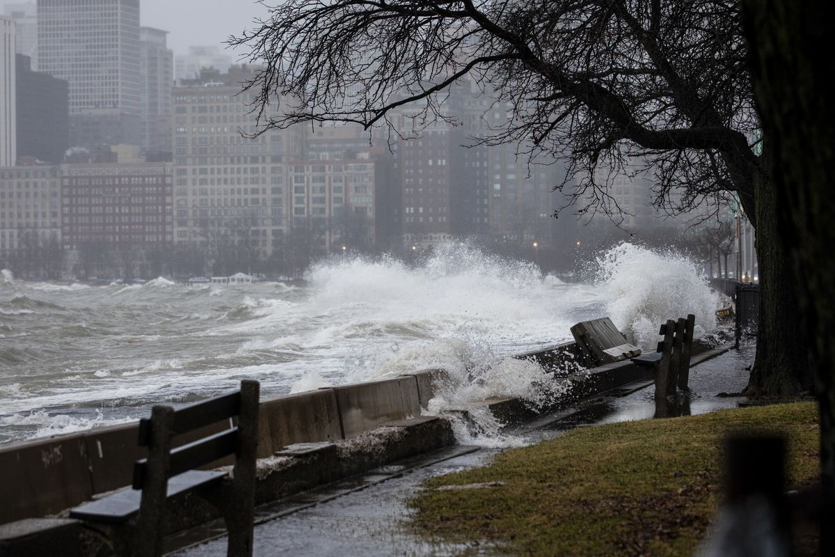 High waves from Lake Michigan hit the lakefront trail near North Avenue as a major winter storm, bringing freezing rain and wind gusts as high as 55 mph, moves through the Chicago area, Saturday afternoon, Jan. 11, 2020.