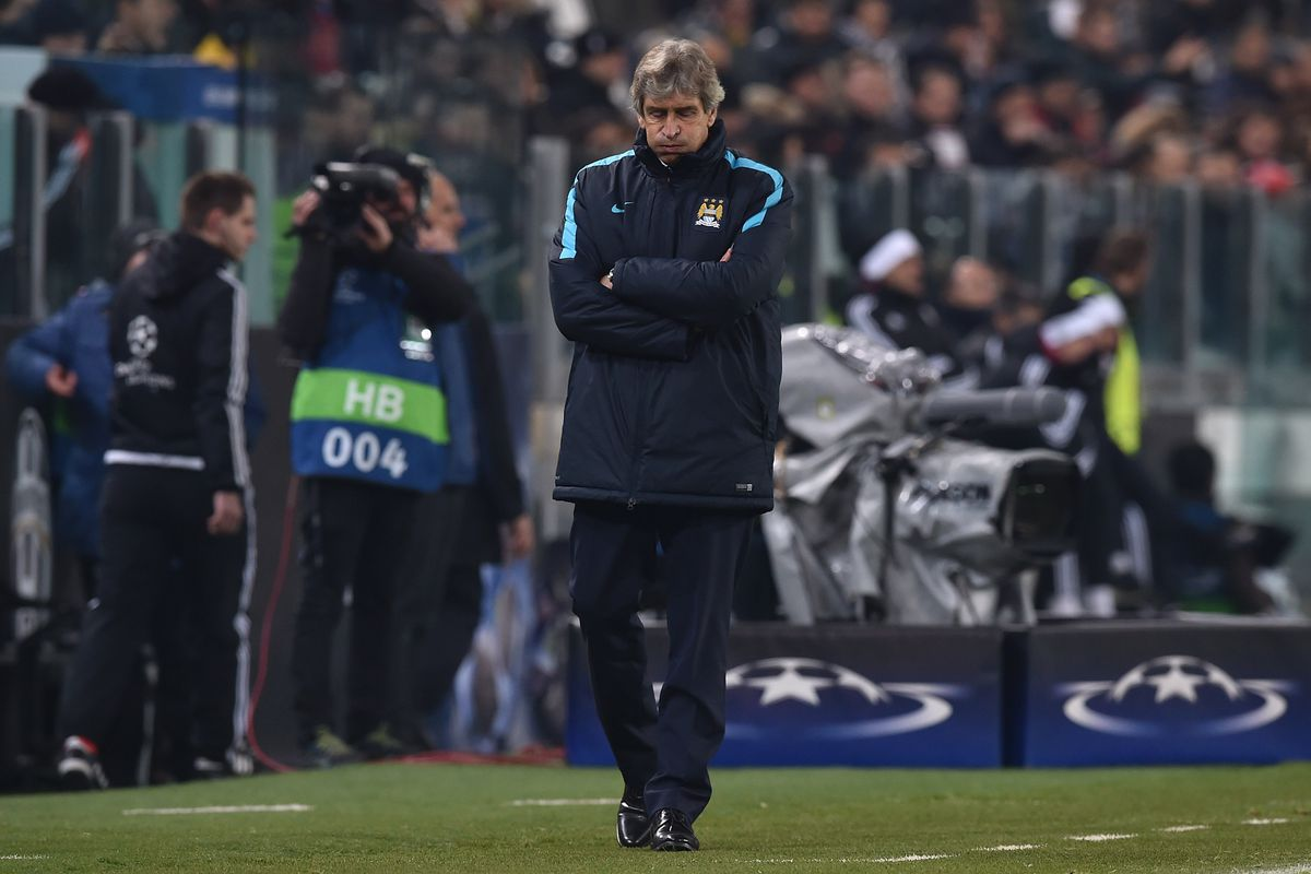 Manchester City FC head coach Manuel Pellegrini looks dejected at the end of the UEFA Champions League group stage match between Juventus and Manchester City FC at Juventus Arena on November 25, 2015 in Turin, Italy.