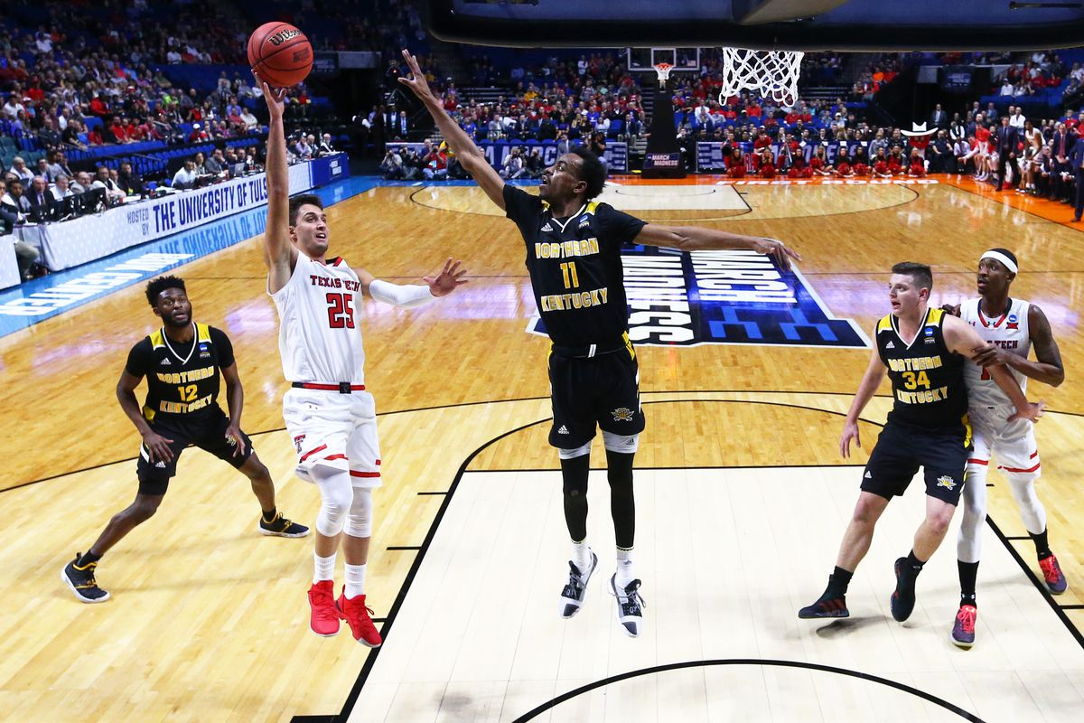 Texas Tech Red Raiders guard Davide Moretti shoots the ball against Northern Kentucky Norse guard Jalen Tate in the first round of the 2019 NCAA Tournament at BOK Center.