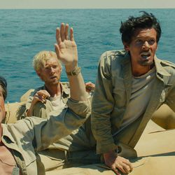 """Mac (Finn Witrock), Phil (Domhnall Gleeson) and Louie (Jack O'Connell) are adrift in """"Unbroken,"""" an epic drama that follows the incredible life of Olympian and war hero Louis """"Louie"""" Zamperini who survived in a raft for 47 days after a near-fatal plane crash in WWII — only to be caught by the Japanese Navy and sent to a prisoner-of-war camp."""