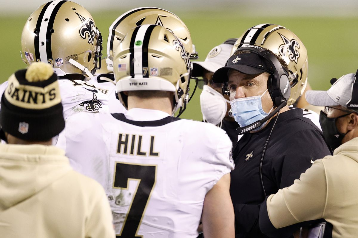 New Orleans Saints Sean Payton talks with Taysom Hill #7 against the Philadelphia Eagles at Lincoln Financial Field on December 13, 2020 in Philadelphia, Pennsylvania.