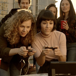 Look, there's something else going on here. It's a roof party and everyone is watching two people play Switch for some reason.